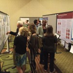 Speaking with delegates at the poster session